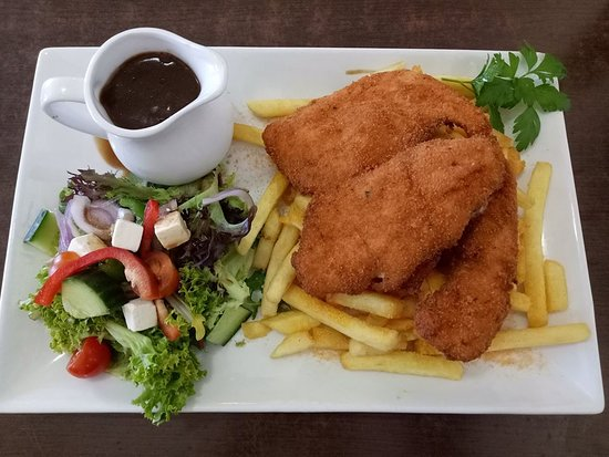Our Famous Chicken Schnitzel With Chips Salad Gravy Picture Of Ocean Crest Cafe Victor Harbor Tripadvisor