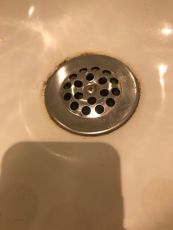 Scum around bathtub drain was never cleaned. - Picture of The Ritz ...