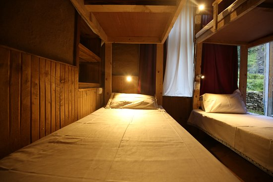 Wooden Bunk Beds With Reading Lamps In Mudhouse Picture Of