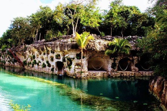 Hotel Xcaret Mexico Water Slide And Caves With Hammocks In Front Of Casa Viento