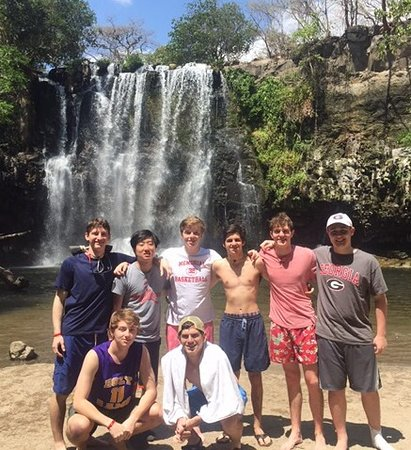 Get Lost In Costa Rica: Young men at the waterfall