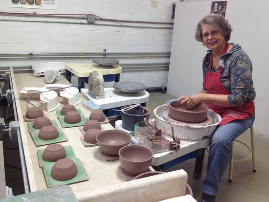 Lisle, IL: Nancy Gorman, a resident artist, shows her throwing skills. See her finished work at our events.