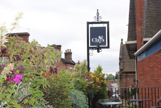 Broseley, UK: Our sign, on the terrace, overlooking the high street