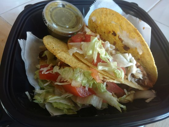 Villa Park, IL: Fish taco and a Al Pastor taco to go.  The fish and pork were seasoned really well.