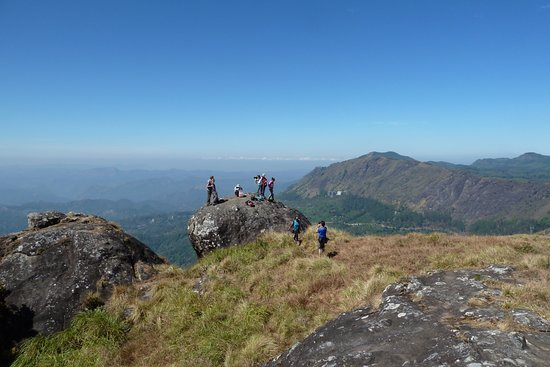 Munnar Trekking Adventure: Our happy group at the peak after b'fast getting ready to resume