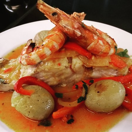 Bacalhau à Marisqueiro | Grilled codfish loin with seafood sauce and shrimp.