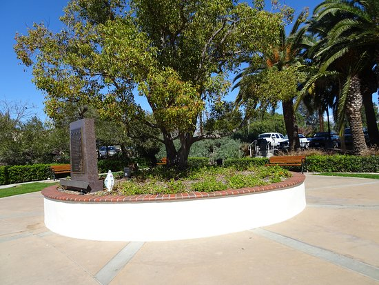 Veteran's Park: Benches surround the raised bed and monument plaque