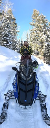 Oakley, UT: Snowmobiling through the woods.
