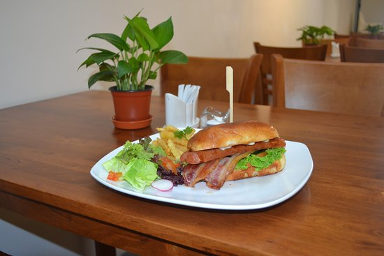 The Line Sandwich Cafe: Pork Sausage Sandwich with Home Made Bread and Barbecue sauce.