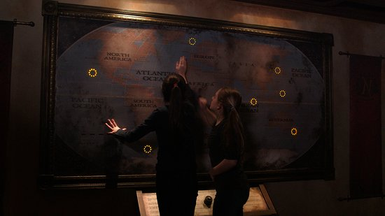 Adventurers solving the clues on a map in 20,000 Leagues - Picture ...