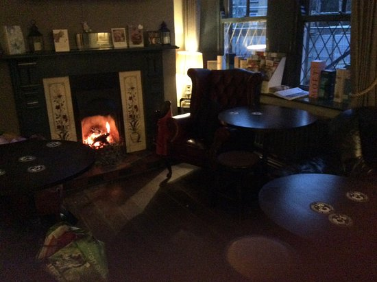 Mytholmroyd, UK: Blazing log fire all evening, with comfortable leather chairs ..