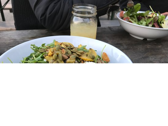 Lucky Penny: Quinoa and arugula salad, market green salad in background, each $12