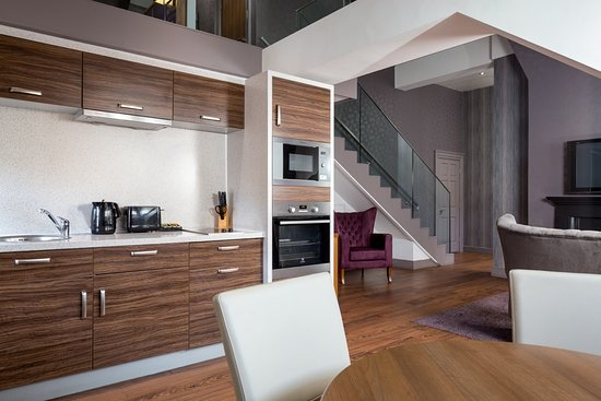 The best places to stay in Newcastle - Shows a large apartment in the Roomzzz Newcastle hotel