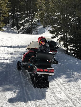 Monarch, CO: Our 8yo on the back of his sled.