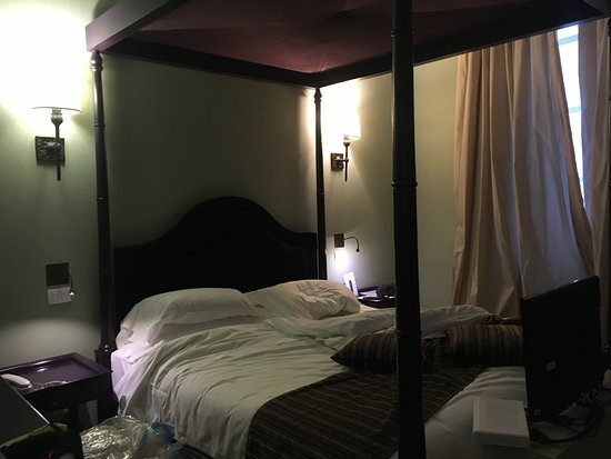 San Firenze Suites u0026 Spa Beautiful bed to show huge copy (8u0027) & Notice beautiful canopy bed and lighted wall art (sorry bed not made ...
