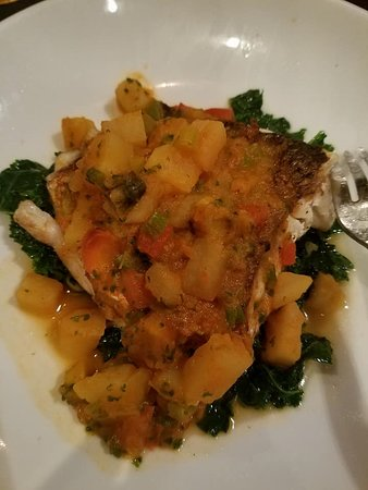 Ilios Noche: Grilled Striped Sea Bass with veggies over a bed of spinach