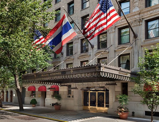 outside view of the hotel plaza athenee with flags of US and Thailand