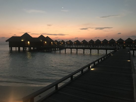 Baros Maldives: Sun set over the water villas