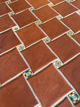 The Inn at Furnace Creek Dining Room : Lovely tile floor through reception area and further
