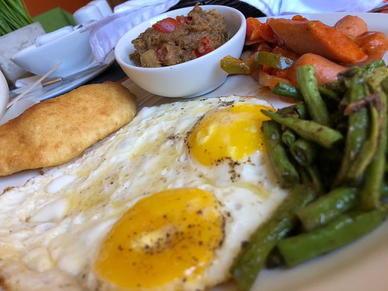 Sans Souci, Trinidad: Geera Bodi with Sunny Side Eggs, Fried Bake, Sausages & Smoked Herring - Breakfast