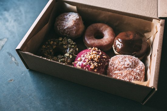 A Box Of 6 Donuts For 12 Picture Of Guilt Trip Coffee