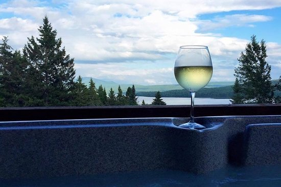 Pittsburg, NH: Enjoy a beautiful view from the hot tub at our Savard cabin.