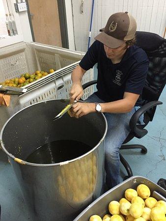 "Fernandina Beach, FL: Hand zesting oranges for Orangecello. ""Old School Artisan Craftsmanship"""