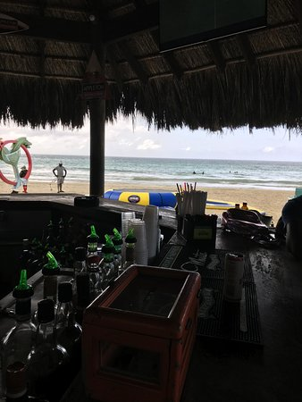 Jimmy Buffett's Margaritaville Negril: sitting under a hut on the beach eating lunch while it was raining
