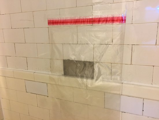 Leo House: missing tile with some type of plastic hanging over it