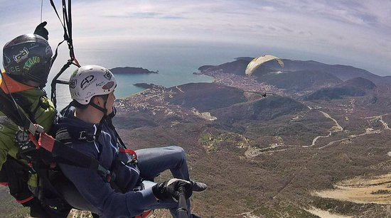 Try paragliding in Becici Montenegro to feel the flight