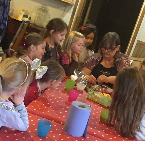 Longhope, UK: Tutor Yvette showing the girls how to make fondant mice,chicks and rabbits.
