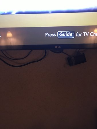 Riverside, MO: TV had cords hanging out from bottom not very professional on the install