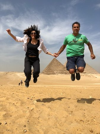 Egypt Tailor Made Day Tours: We rode camels behind the pyramids and the young man leading us took hilarious pictures.