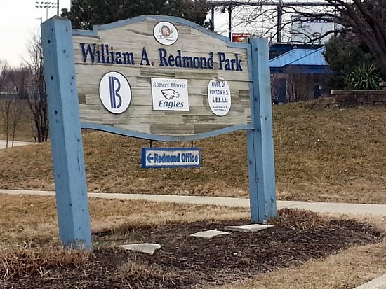 Bensenville Park District sign for William A. Redmond Park - home of the Water's Edge Aquatic Ce