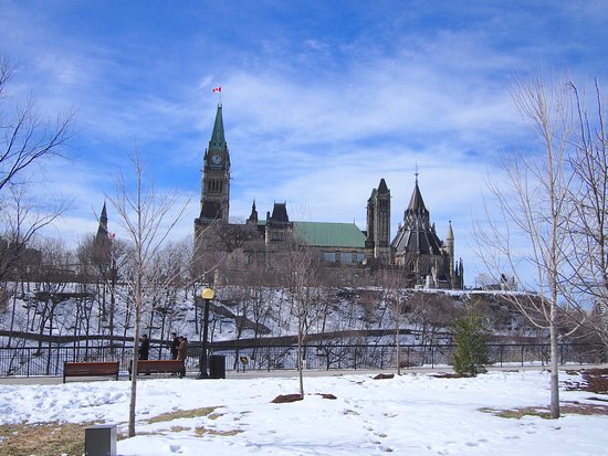 Ottawa, Canada: Parliament Hill taken from park across Rideau Canal