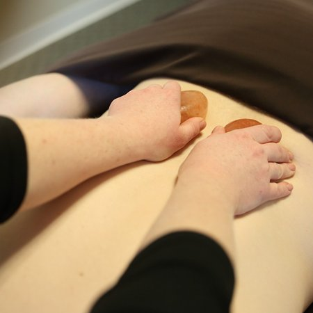 Des Moines, IA: We incorporate warm Himalayan salt stones into our signature massages.