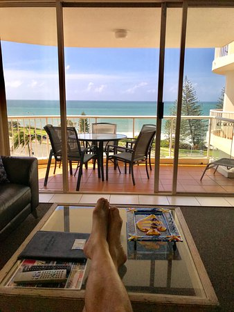 Osprey Apartments: Sitting on the couch in the main living room, taking in a cool breeze and enjoying the view!