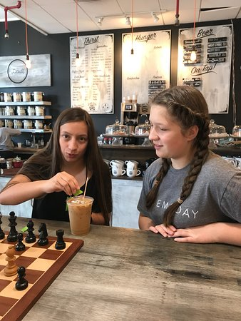 The Blind Tiger Cafe: Zoe and Zia enjoying a game of chess and ice coffee