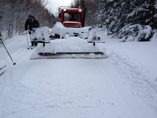 Greenville, ME: AMC groomer has tracker, but refused to set one set on right. See skiers creating their own.