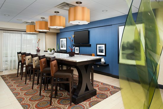 The Communal Table Located In Our Lobby Features Barheight Stools - Bar height communal table