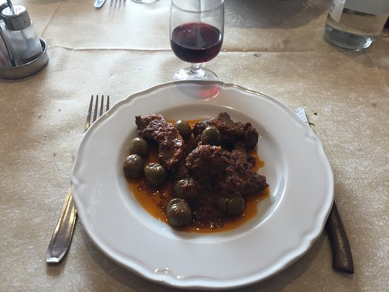 Lustignano, Italy: Wild boar with olives.