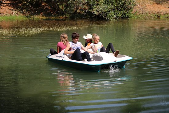 Trinity Center, CA: Paddle boating in our pond