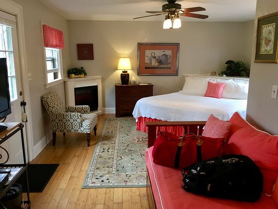 The bedroom area of the private cottage, complete with electric fireplace!