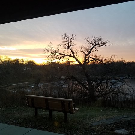 Crystal Lake, IL: Sunset out the windows at the Nature Center, looking at the pond.