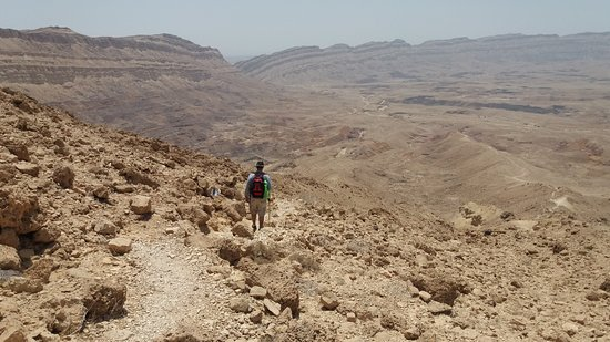 Southern District, Israel: Hiking down into the crater. Devils Gate in the distance.