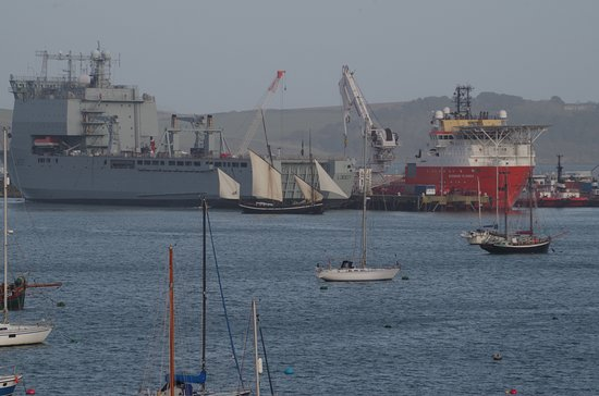The Greenbank Hotel : Fleet Auxiliary ships under refit & a sloop passing in front.