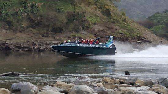 Tour Aotearoa riders on the Whanganui River Adventures Jet boat Pipiriki and having a compliment