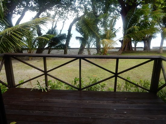 Peleliu, Palau: View of Grass Area, Beach and Ocean from Front Deck