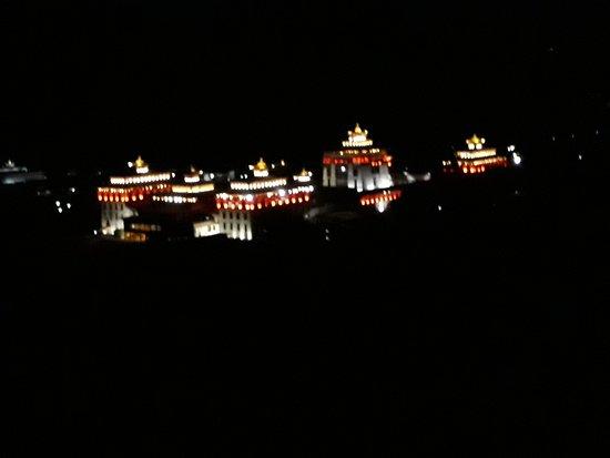 Dark walk with majestic view of Thimphu Dzong along the stars