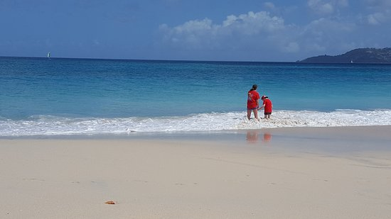 South Coast, Grenada: Our kids playing in the waves